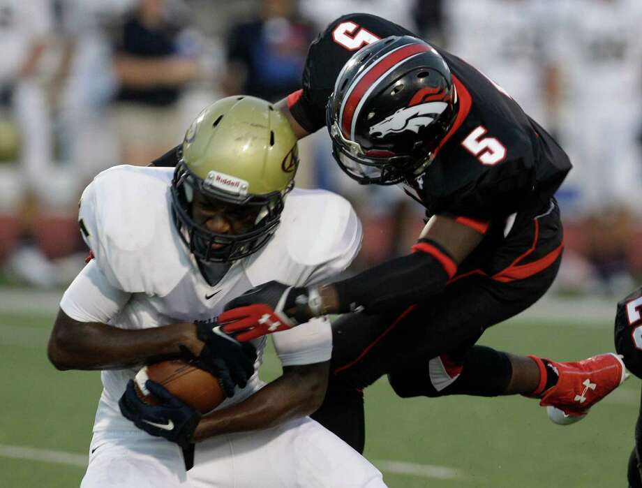 Cameron Green of Klein Collins is tackled by Jeremy Edwards of Westfield  during the first quarter. Photo: Melissa Phillip, Houston Chronicle / © 2013  Houston Chronicle