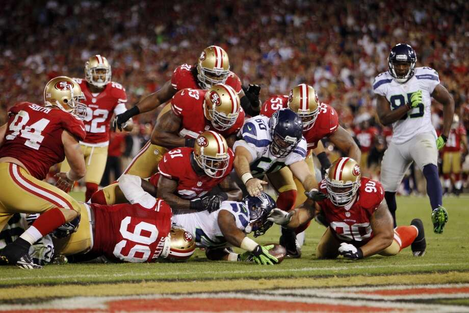 Seahawks 6, 49ers 13 Oct. 18, 2012   Candlestick Park, San Francisco  In perhaps the most grueling matchup yet between the two teams, the 49ers slogged out a 13-6 win against the Russell Wilson-led Seahawks in San Francisco. The two teams traded early blows, but Seattle could not slow running back Frank Gore, as Gore trudged his way to 131 yards on the night. Photo: Brian Bahr, Getty Images
