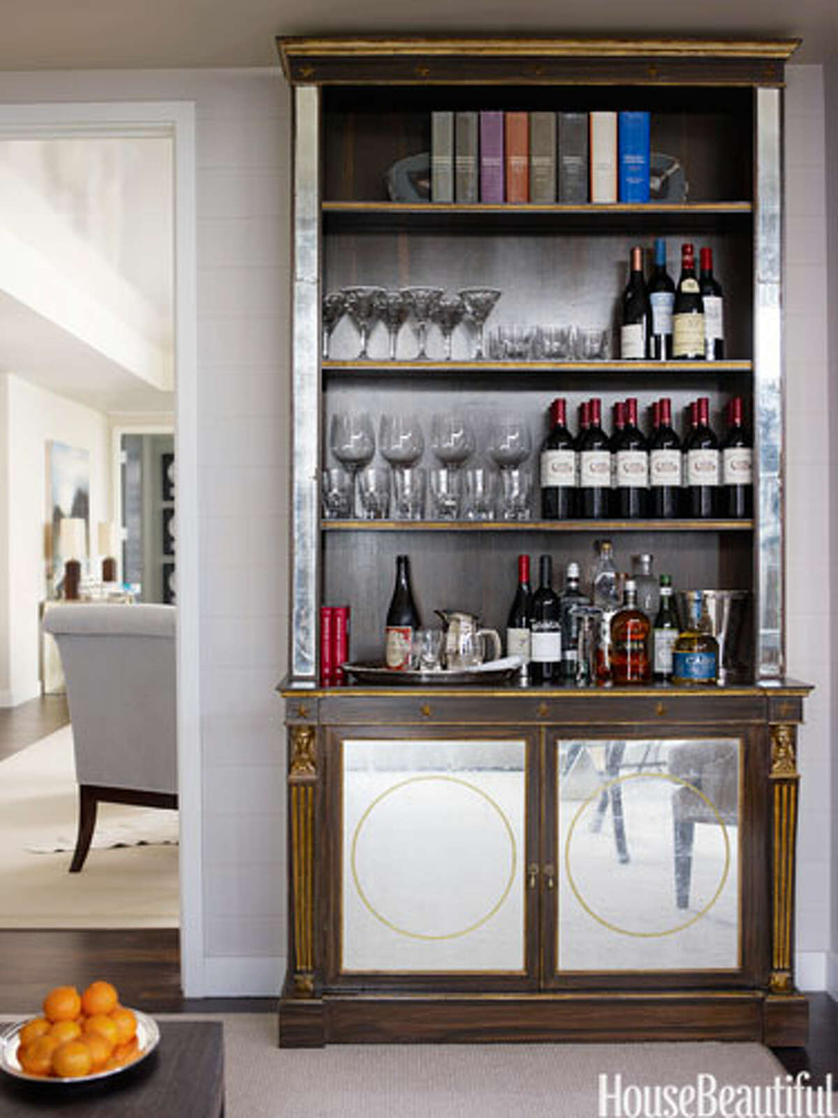 Bookcase Bar An antique bookcase doubles as a bar in this Manhattan apartment designed by Phoebe and Jim Howard. Glassware by William Yeoward Crystal.