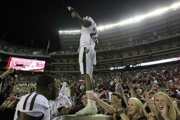 Texas A&M defensive back Dustin Harris knows how to stand out in a crowd while celebrating last November's 29-24 win over No. 1 Alabama. The Crimson Tide's fandom hopes the result isn't repeated Saturday.