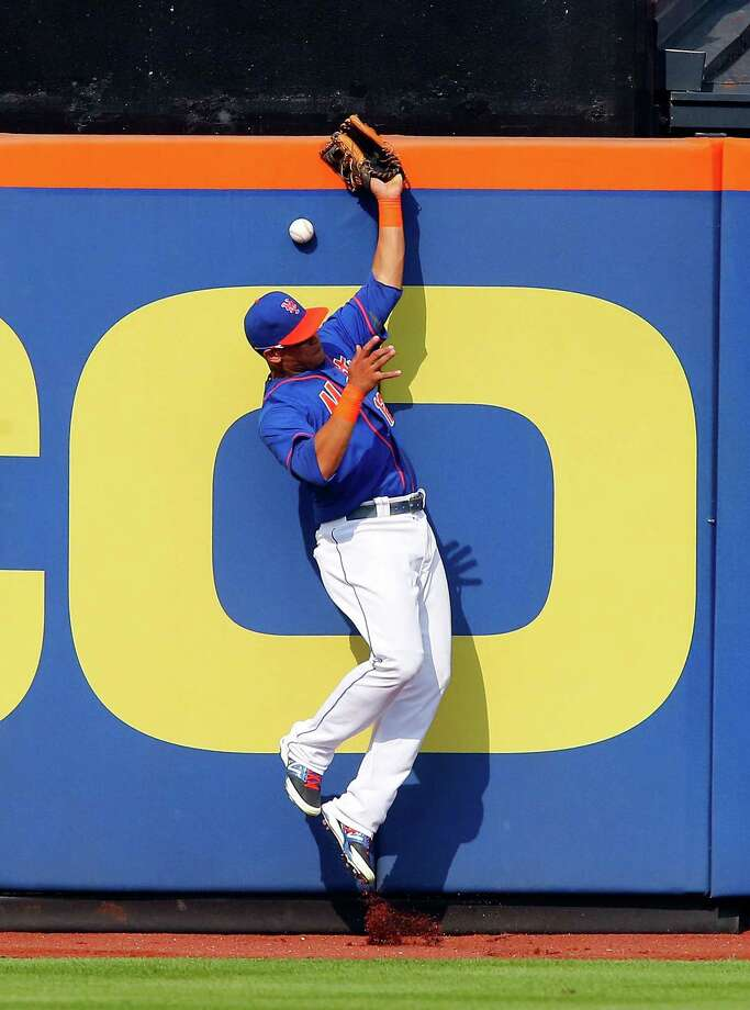 NEW YORK, NY - SEPTEMBER 12:  Juan Lagares #12 of the New York Mets can't come up with a ball hit for a seventh inning double by Adam LaRoche #25 of the Washington Nationals at Citi Field on September 12, 2013 in the Flushing neighborhood of the Queens borough of New York City. The Nationals defeated the Mets 7-2.  (Photo by Jim McIsaac/Getty Images) ORG XMIT: 163495489 Photo: Jim McIsaac / 2013 Getty Images