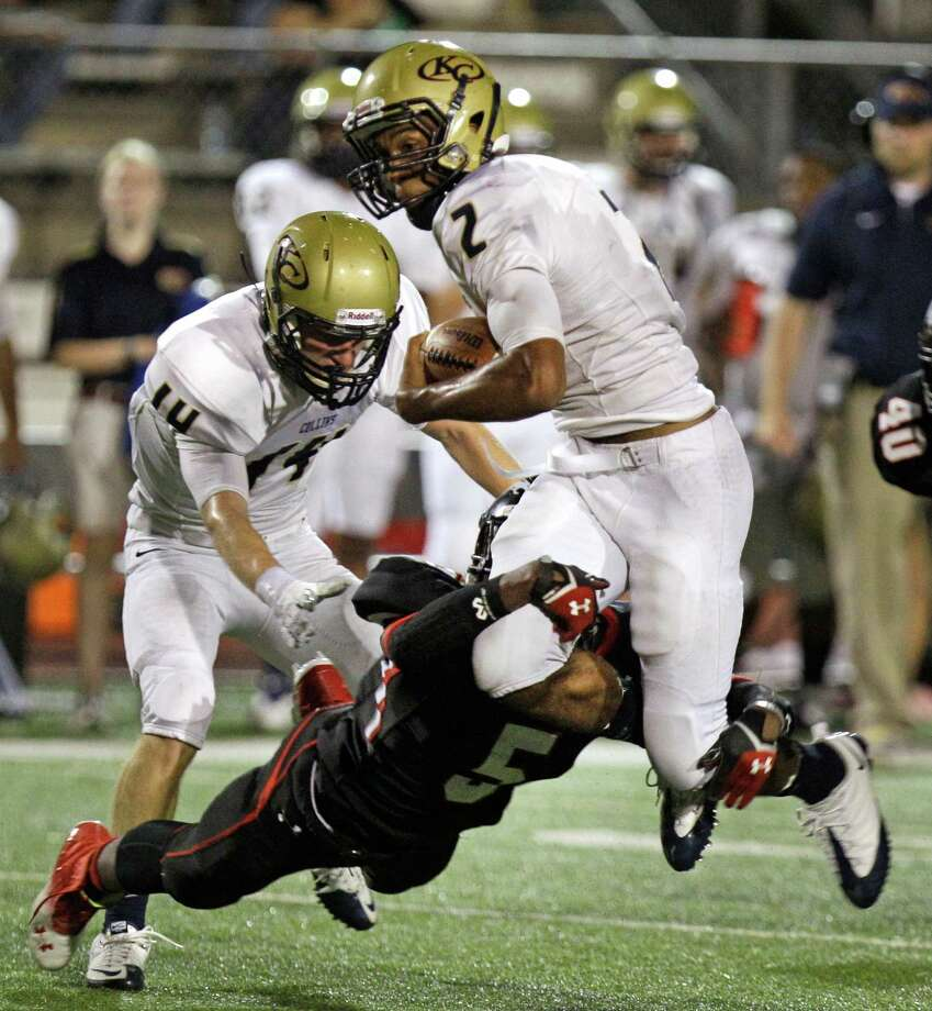 Klein quarterback Jordan Thomas is tackled by Jeremy Edwards of Westfield during the third quarter. Photo: Melissa Phillip, Houston Chronicle / © 2013  Houston Chronicle