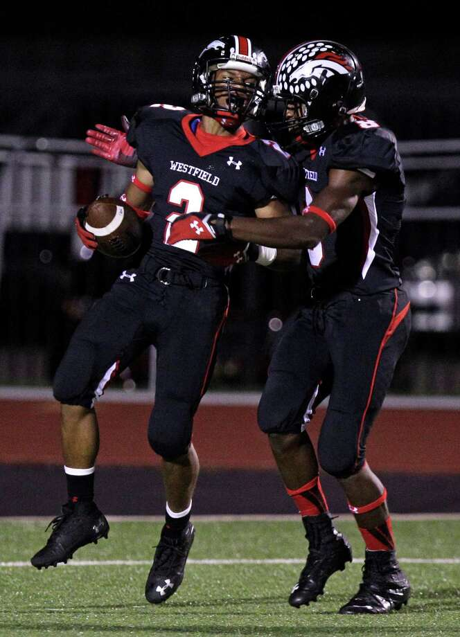Latevius Downs of Westfield  celebrates his touchdown with teammate Donovan Thompson during the fourth quarter. Photo: Melissa Phillip, Houston Chronicle / © 2013  Houston Chronicle