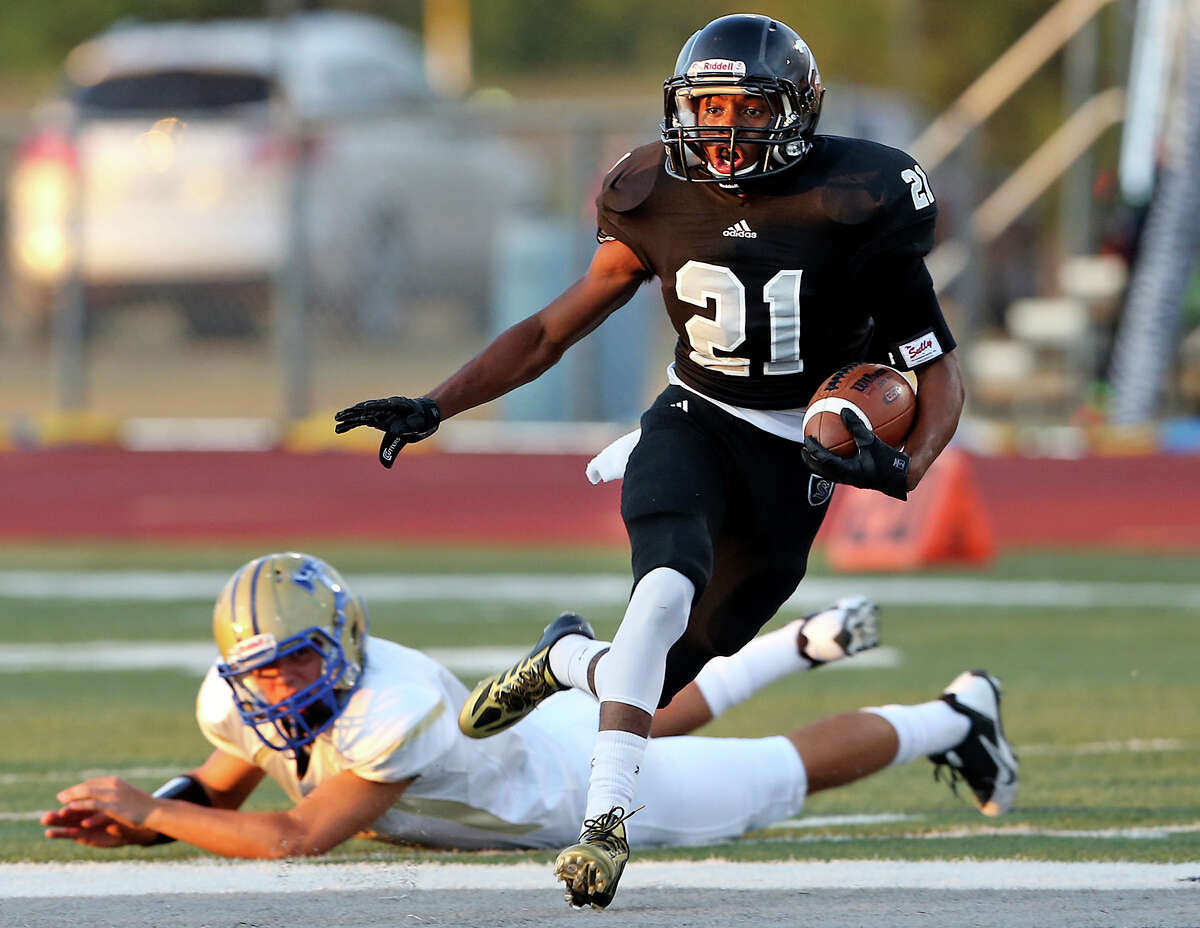 D'Angelo Wallace takes off after alluding a tackler in the first quarter as Steele hosts Tivy at Lehnhoff Stadium on September 12, 2013.