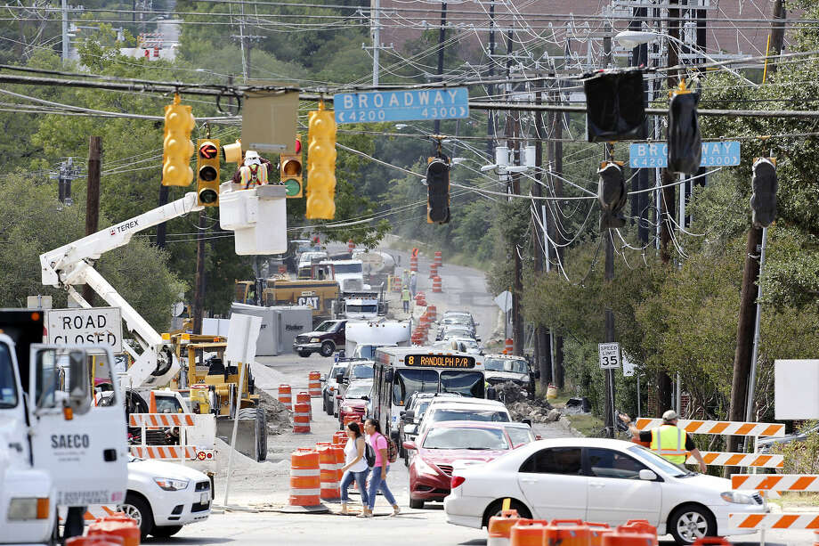 Pedestrians pick their way through heavy traffic and construction gear at Hildebrand Avenue and Broadway. Photo: Edward A. Ornelas / San Antonio Express-News