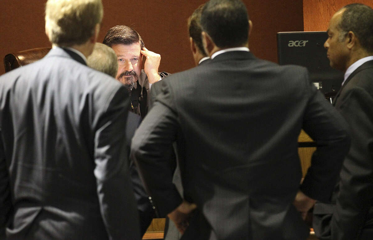 District Judge Dib Waldrip holds a conference with attorneys during a hearing regarding the Scientology lawsuit.