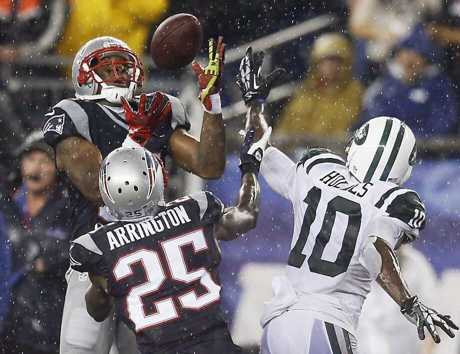 Cornerback Aqib Talib (left) intercepts a pass in the fourth quarter that was intended for receiver Santonio Holmes. Photo: Elise Amendola, Associated Press