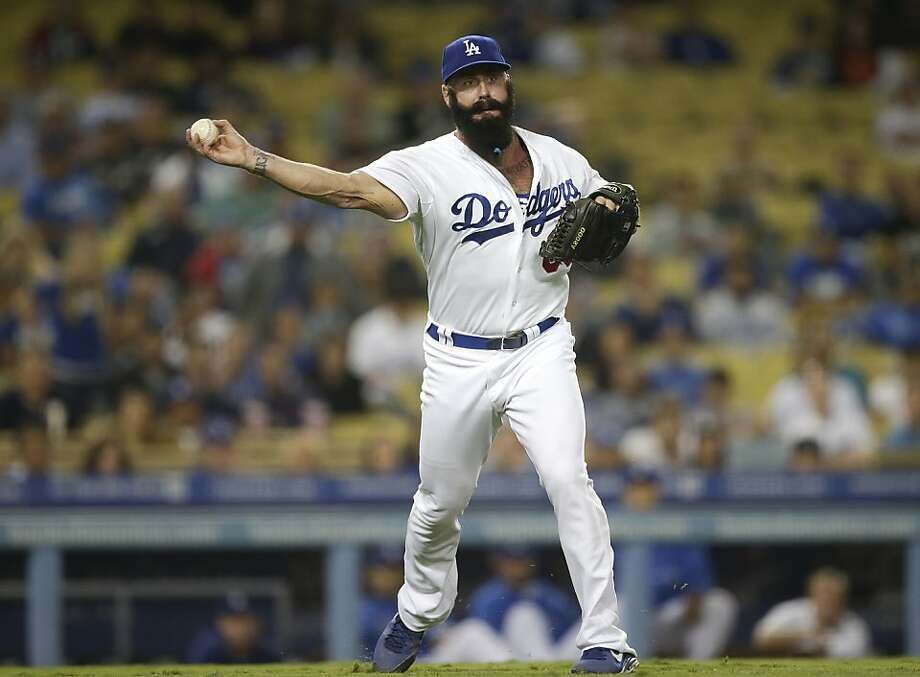 Dodgers reliever Brian Wilson got the win in his first game against the Giants. Photo: Jae C. Hong, Associated Press