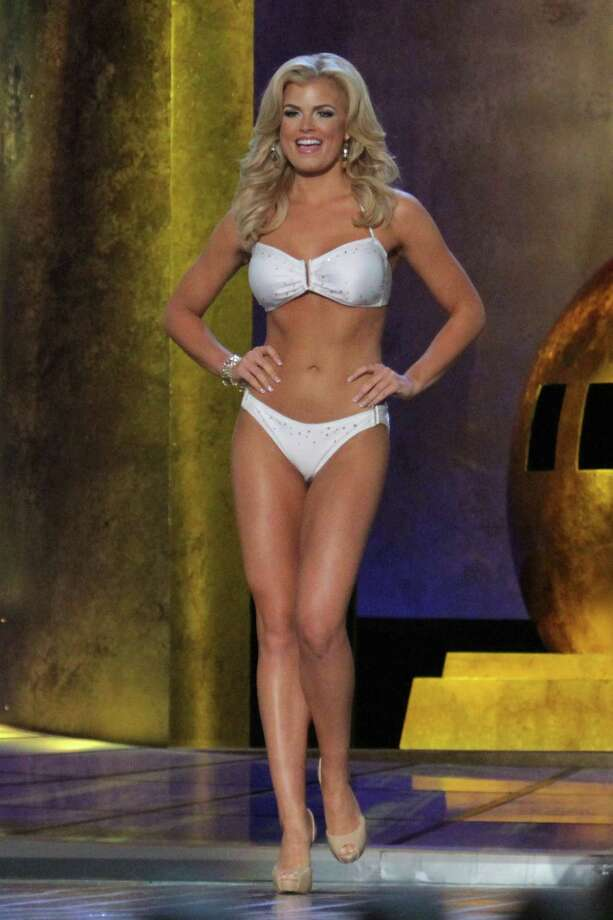 Miss Georgia, Carly Mathis, the preliminary Lifestyle and Fitness winner in a white Catalina swimsuit attends 2014 Miss America News Competition - Preliminary Round 3 at Atlantic City Boardwalk Hall on September 12, 2013 in Atlantic City, New Jersey. Photo: Donald Kravitz, Getty Images / 2013 Donald Kravitz