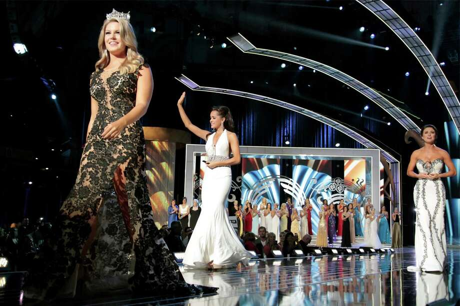 (L-R) Miss America 2013, Mallory Hagan, Miss Minnesota, Rebecca Yeh  and Miss Oklahoma, Kelsey Griswold walk the runway as they attend 2014 Miss America News Competition - Preliminary Round 1 at Atlantic City Boardwalk Hall on September 11, 2013 in Atlantic City, New Jersey. Photo: Donald Kravitz, Getty Images / 2013 Donald Kravitz