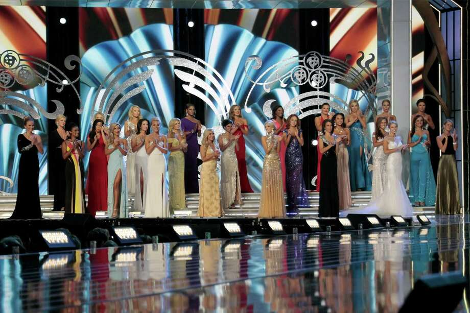 Miss America Contestants take the stage as they attend 2014 Miss America News Competition - Preliminary Round 1 at Atlantic City Boardwalk Hall on September 11, 2013 in Atlantic City, New Jersey. Photo: Donald Kravitz, Getty Images / 2013 Donald Kravitz