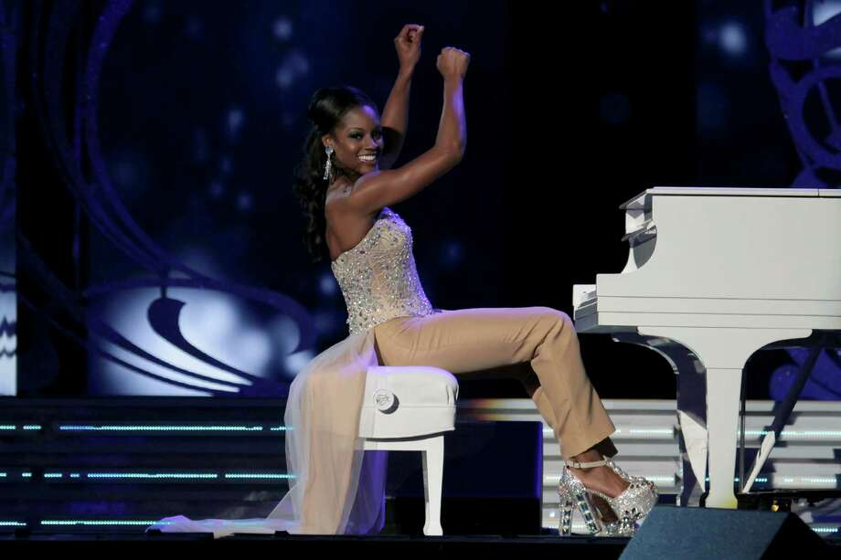 Miss Virginia, Desiree Williams performs a contemporary piano piece as she  attends 2014 Miss America News Competition - Preliminary Round 1 at Atlantic City Boardwalk Hall on September 11, 2013 in Atlantic City, New Jersey. Photo: Donald Kravitz, Getty Images / 2013 Donald Kravitz
