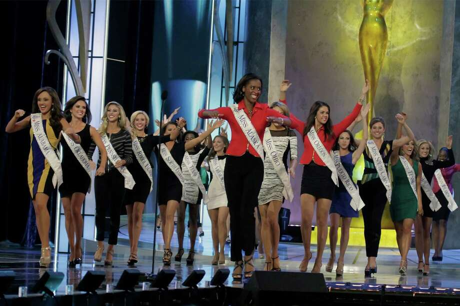 Contestants open the 2014 Miss America News Competition - Preliminary Round 1 at Atlantic City Boardwalk Hall on September 10, 2013 in Atlantic City, New Jersey. Photo: Donald Kravitz, Getty Images / 2013 Donald Kravitz