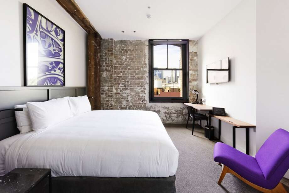 Architectural details such as the building's brick walls and original wood beams are on display in 1888 Hotel's rooms.