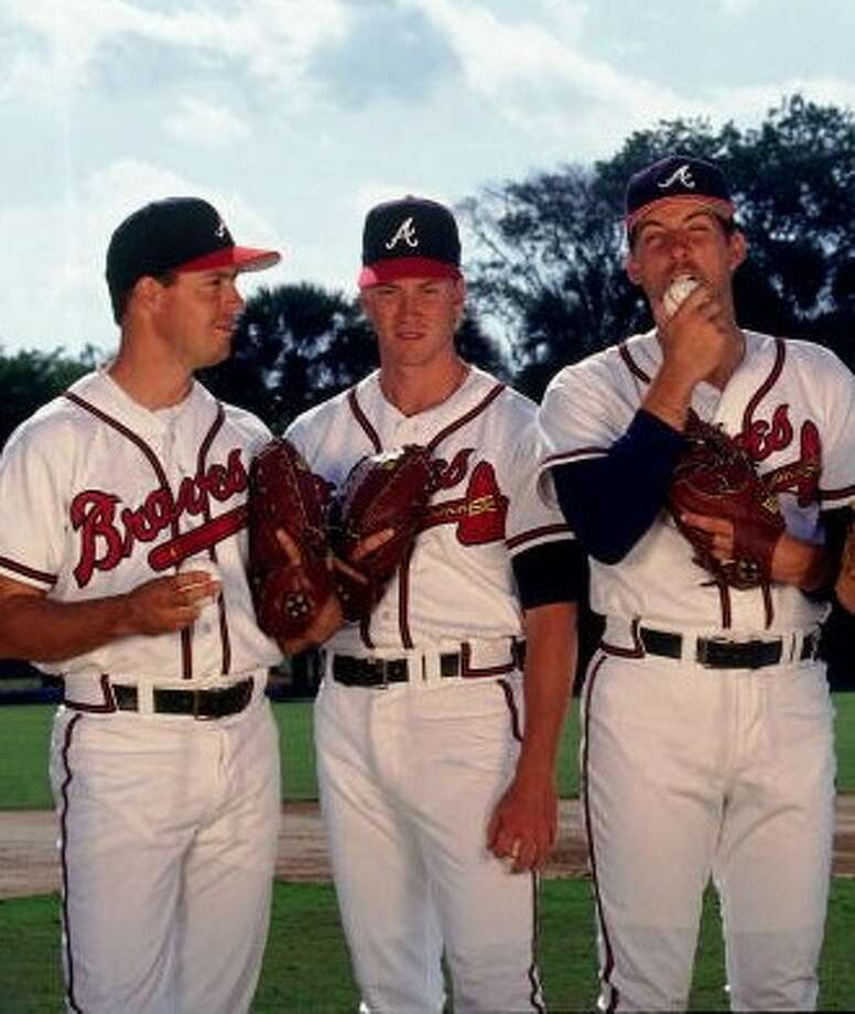 Greg Maddux, left, topped an Atlanta Braves rotation with Tom Glavine and John Smoltz that powered the Braves to 14 consecutive division titles and one World Series title. Photo: Ronald C. Modra , Sports Imagery Getty Images