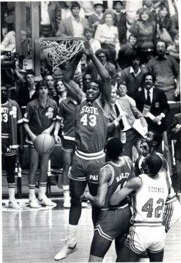 Lorenzo Charles -- Lo and behold, look what I found. The accidental dunk cost the Cougars a national title.