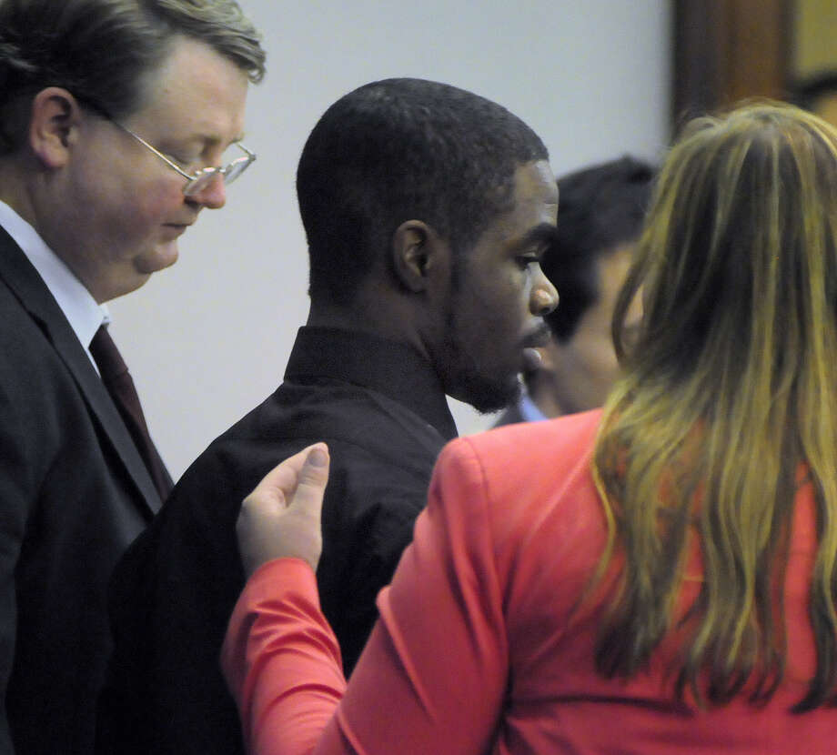 "De'Marquise Elkins, center, stands with his lawyers, public defender Kevin Gough and assistant public defender Elizabeth Ashley Wood, as he is sentenced, Thursday, Sept. 12, 2013 in Brunswick, Ga. Elkins convicted of fatally shooting a baby in a stroller was sentenced Thursday to spend the rest of his life in prison with no chance of parole after the grieving mother asked a judge to punish the gunman for taking ""the love of my life."" Photo: The Brunswick News/Bobby Haven"