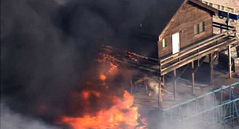 In this image taken from video and provided by Fox 29, flames engulf a building on the boardwalk in the resort community of Seaside Park, N.J., Thursday, Sept. 12, 2013. The massive fire burned several blocks of boardwalk and businesses along the popular stretch of boardwalk, which was damaged by Superstorm Sandy and was being reparied. (AP Photo/Fox 29) NO SALES  ORG XMIT: NYR103 Photo: AP / FOX 29