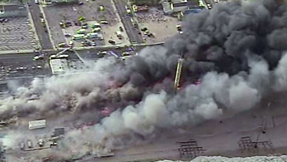This image from aerial video shows a raging fire in Seaside Park, N.J. on Thursday, Sept. 12, 2013. The fire began in a frozen custard stand on the Seaside Park section of the boardwalk and quickly spread north into neighboring Seaside Heights. (AP Photo/ABC) ORG XMIT: NY115 Photo: Uncredited, AP / ABC