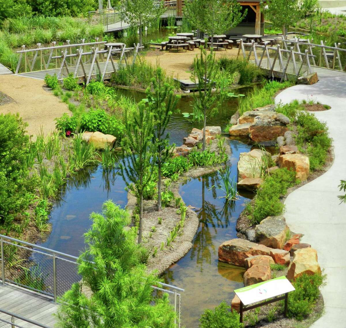 Kids can explore a watery ecosystem in the one-acre Texas Native Wetlands in the garden.