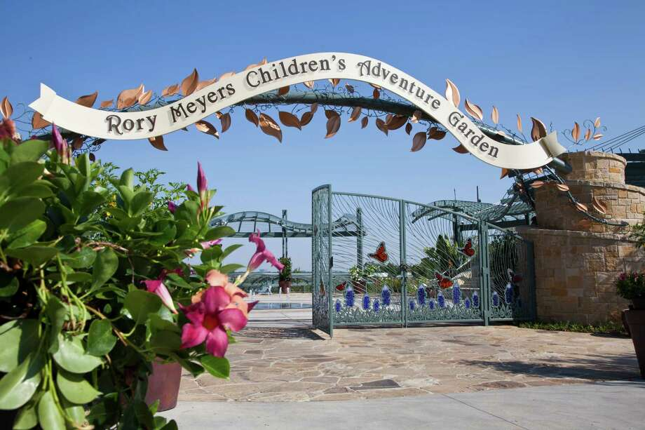 Glass bluebonnets, the state flower, and monarch butterflies, the state insect, dress the gates at the Rory Meyers Children's Adventure Garden.  Photo courtesy of the Dallas Arboretum Photo: Lisa Means, LM PHOTOGRAPHY