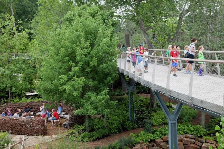 Kids get a squirrel's view from The Texas Skywalk while others learn about science in an eagle's nest the Rory Meyers Children's Adventure Garden.  Photo courtesy of the Dallas Arboretum