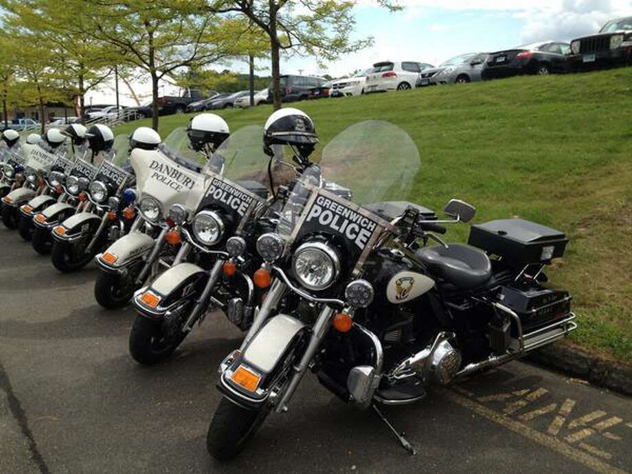 "Motorcyles lined up at the O'Neil Center in Danbury, Conn where the funeral service for ""TJ"" Todd Lobraico is being held, Friday, Sept. 13, 2013. Photo: Contributed Photo"