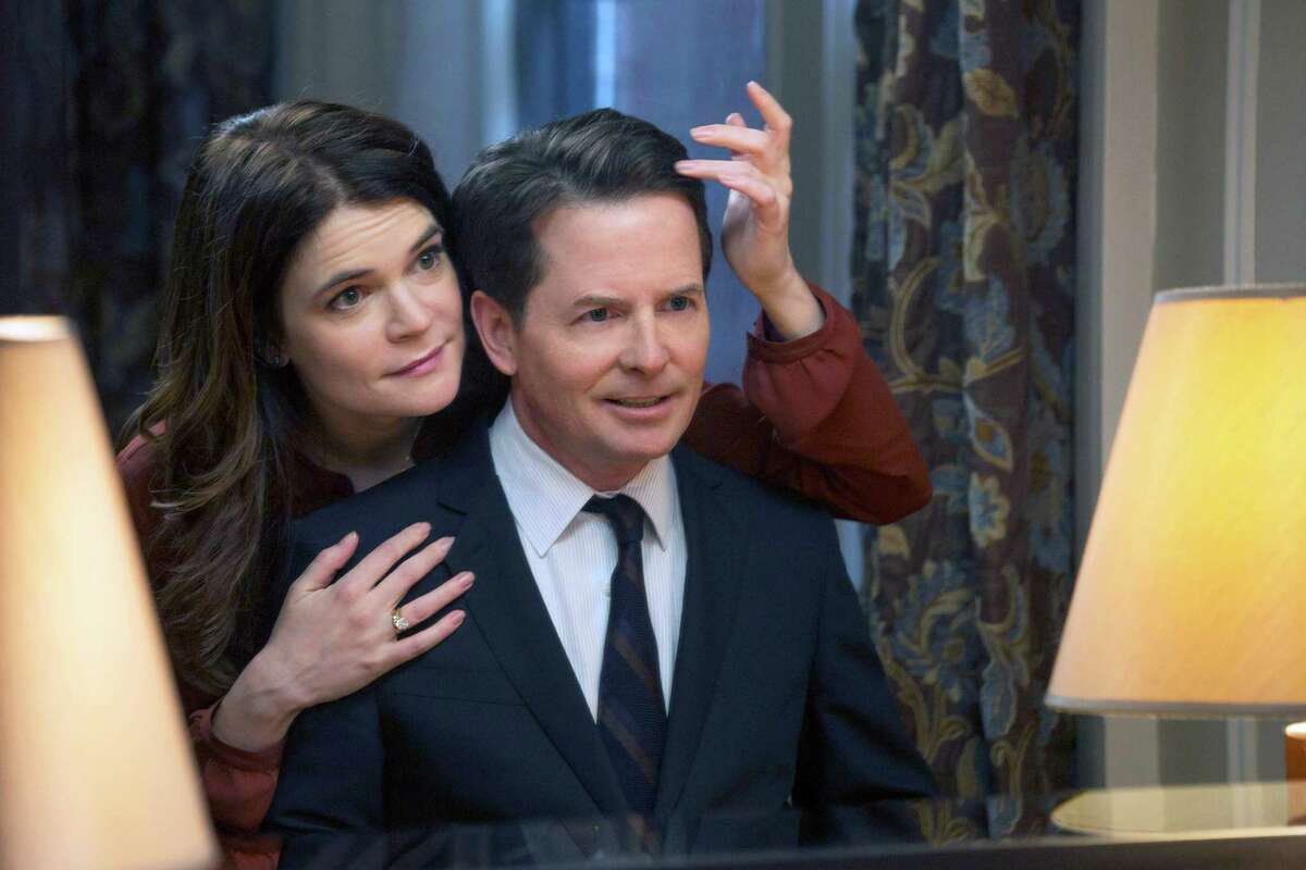 Betsy Brandt and Michael J. Fox play a married couple on