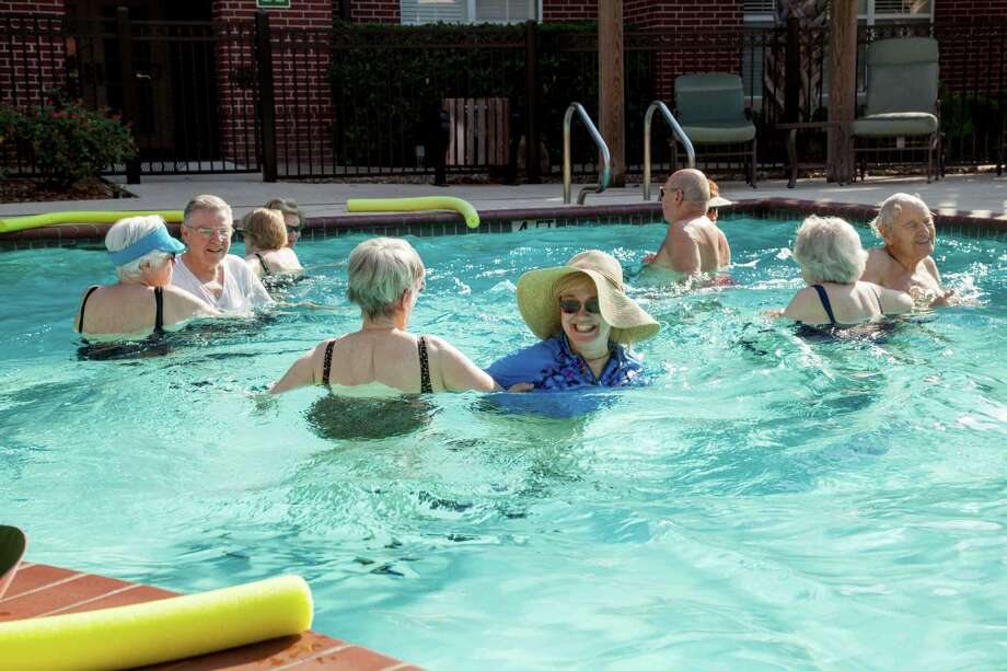 Residents at The Buckingham enjoy a weekly water aerobics class.