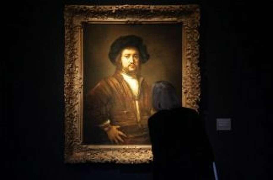 A woman admires a Rembrandt