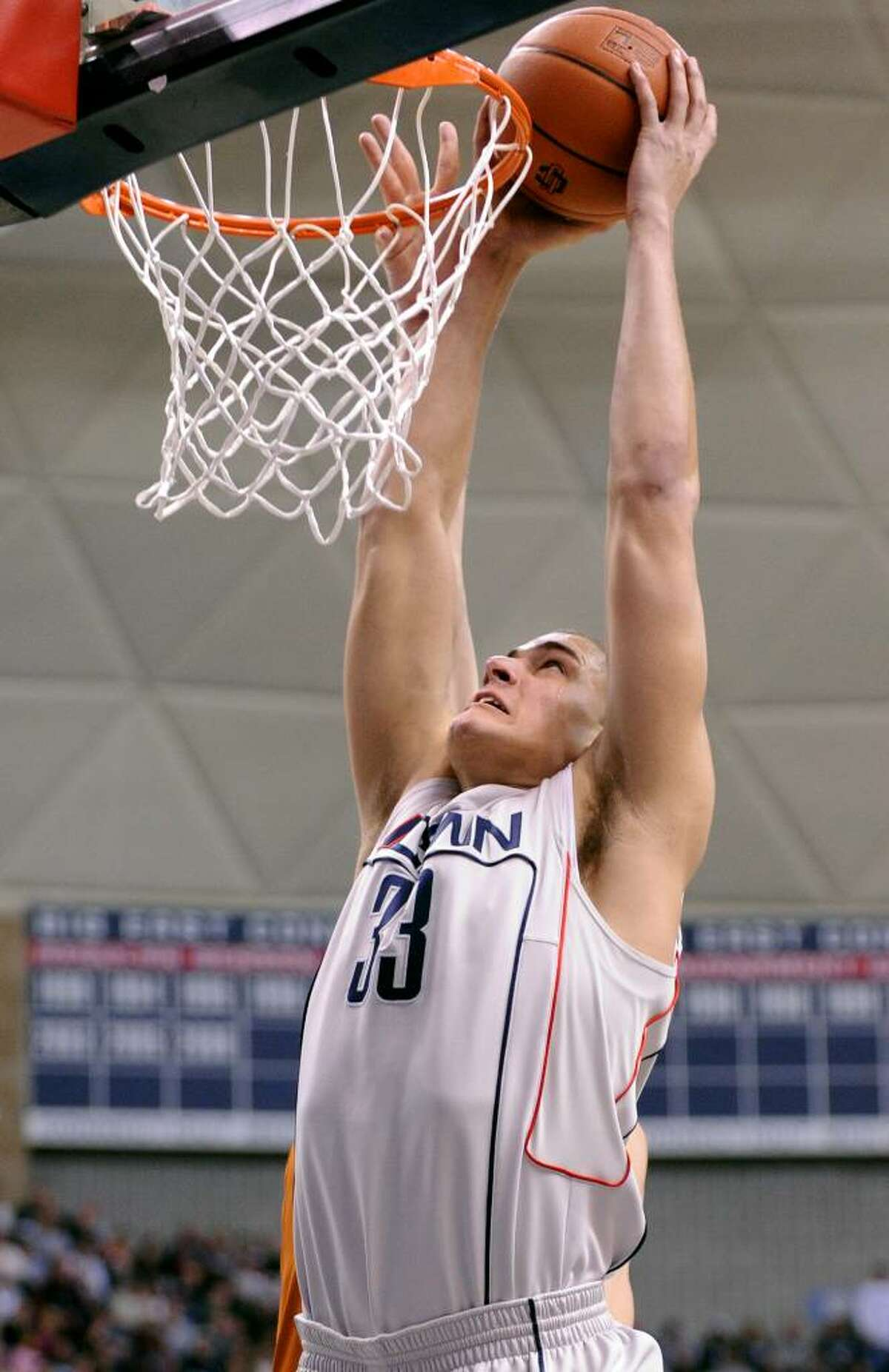 UConn's Gavin Edwards dunks the ball during the first half of Saturday's game against Texas at Gampel Pavilion.