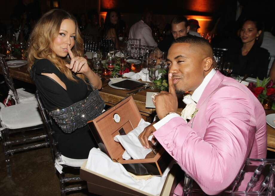 Mariah Carey gives Nas a Louis Vuitton Cigar Humidor as Joel Kinnaman and Olivia Munn look on at his 40th Birthday Celebration Dinner And Party at Avenue NYC on September 12, 2013 in New York City.  (Photo by Jerritt Clark/Getty Images) Photo: Jerritt Clark, Getty Images