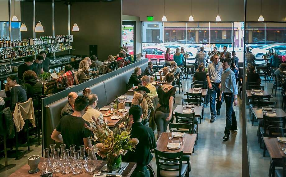 The Acquerello team's 1760 features a long, narrow bar and large windows overlooking a busy San Francisco corner. Photo: John Storey, Special To The Chronicle