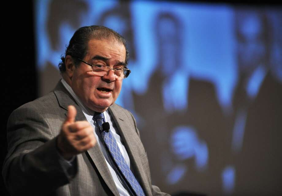 """Voting Rights Act, 2013, Scalia voting to throw out a key provision regularly renewed by Congress: """"Whenever a society adopts racial entitlements, it is very difficult to get out of them through the normal political processes. I don't think there is anything to be gained by any Senator to vote against continuation of this act.  """"And I am fairly confident it will be enacted in perpetuity unless -- unless a court can say it does not comport with the Constitution."""" Photo: JEWEL SAMAD, AFP/Getty Images"""