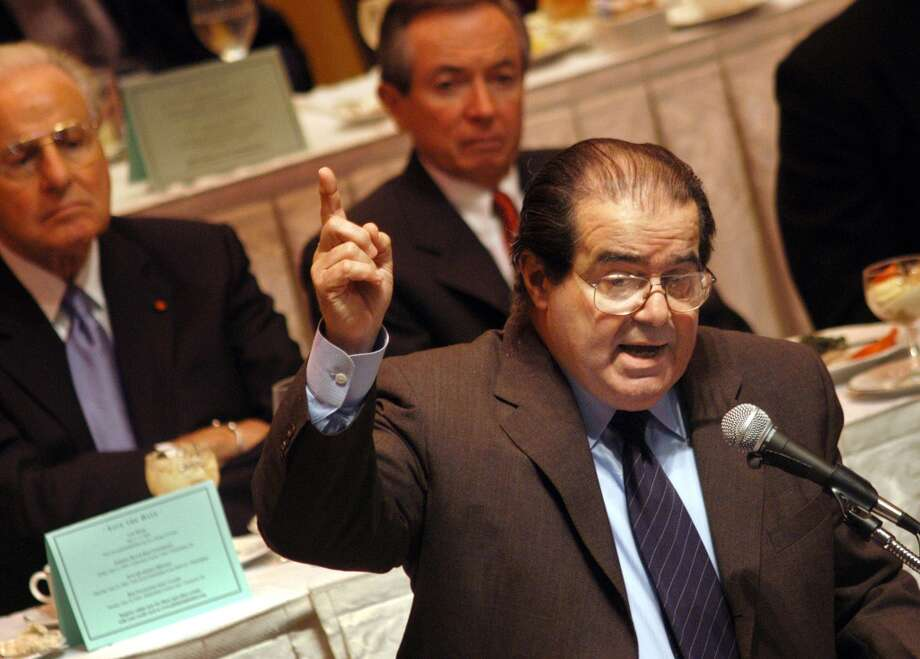 """Arizona v. United States (Scalia dissent, court ruling on state law against undocumented residents):  """"We are not talking here about a federal law prohibiting the states from regulating bubble-gum advertising, or even the construction of nuclear plants.  We are talking about a federal law going to the core of state sovereignty -- the power to exclude.  """"The Court opinion's looming specter of inutterable horror -- 'if Sec. 3 of the Arizona statute were valid, ever State could give itself independent authority to prosecute federal registration violations"""" -- seems to me not so horrible and even less looming.  """"If securing its territory in this fashion is not within the power of Arizona, we should cease referring to it as a sovereign state."""" Photo: William Thomas Cain, Getty Images"""