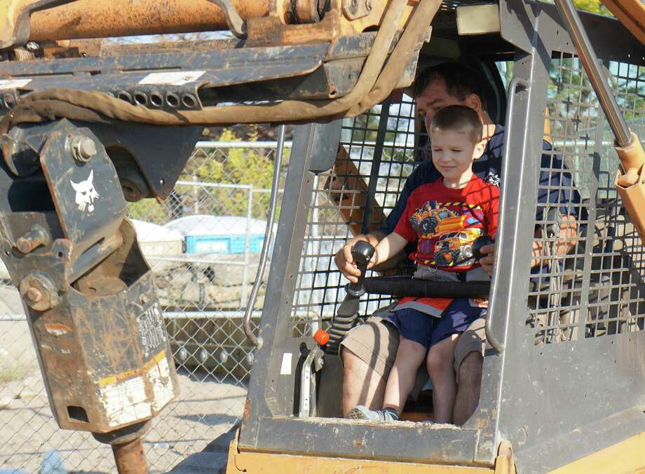 Five-year-old Travis Rekos helps out Friday morning during the construction of a new playground at Penfield Beach in honor of his sister, Jessica, who waskilled in the Sandy Hook Elementary School shooting. Photo: Genevieve Reilly / Fairfield Citizen