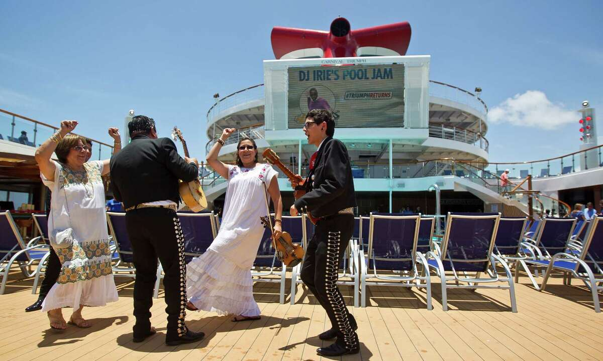 Members of the mariachi group Mariachi Los Gallitos dance as they entertain guests who are boarding the Carnival Triumph cruise ship, Thursday, June 13, 2013, at the Port of Galveston in Galveston.