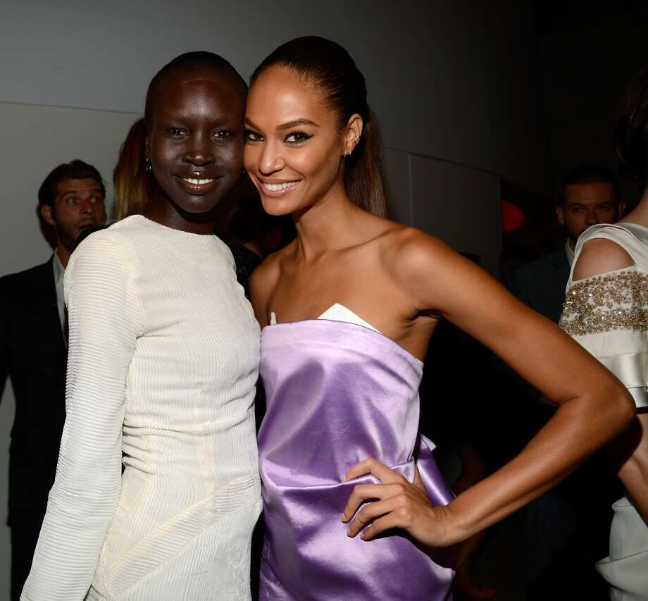 "Model Alek Wek (L) and Joan Smalls attend the Estee Lauder ""Modern Muse"" Fragrance Launch Party at the Guggenheim Museum on September 12, 2013 in New York City.  (Photo by Kevin Mazur/Getty Images for Estee Lauder) Photo: Kevin Mazur"