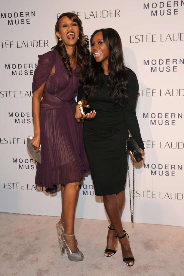 "Model Iman (L) and InStyle Beauty Director Kahlana Barfield attend the Estee Lauder ""Modern Muse"" Fragrance Launch Party at the Guggenheim Museum on September 12, 2013 in New York City.  (Photo by Bryan Bedder/Getty Images for Estee Lauder) Photo: Bryan Bedder"
