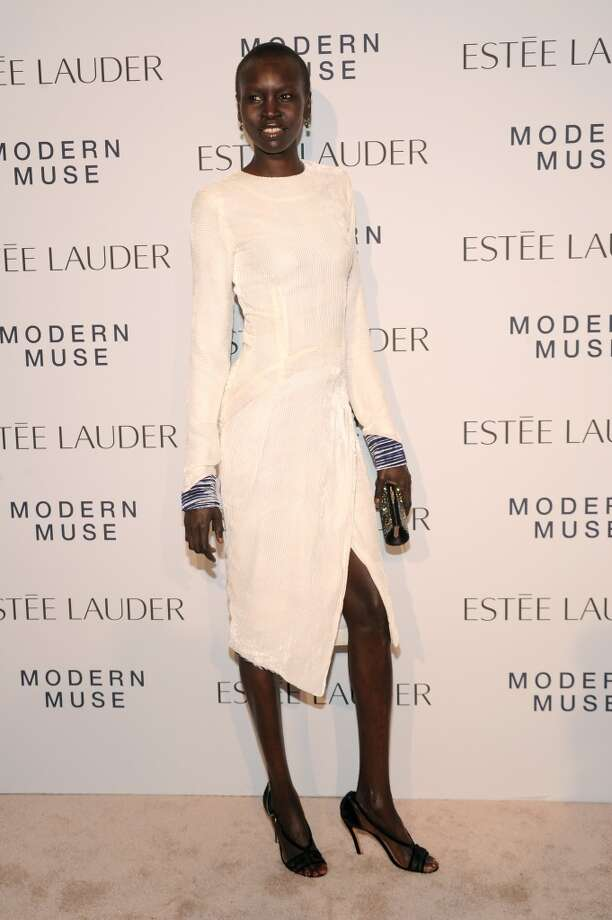 "Model Alek Wek attends the Estee Lauder ""Modern Muse"" Fragrance Launch Party at the Guggenheim Museum on September 12, 2013 in New York City.  (Photo by Bryan Bedder/Getty Images for Estee Lauder) Photo: Bryan Bedder"