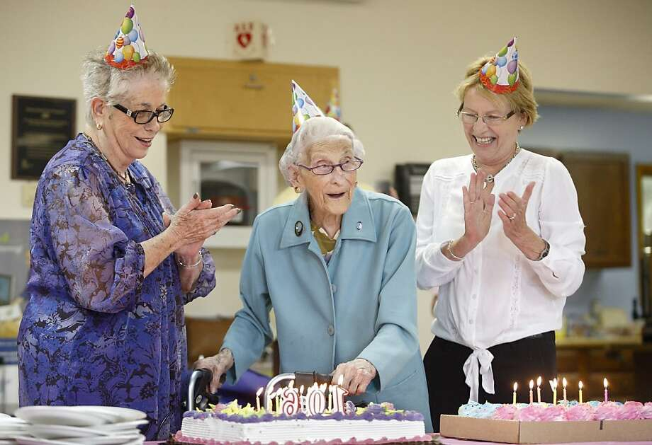 Surprise! You're 106! Assemblywoman Aileen Gunther (right) and her legislative 