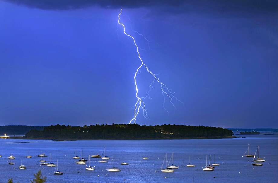 Electrical inlet:The Nation Weather Service estimates there were more than 1,000 lightning strikes per hour at the height of this storm north of Macworth Island in Portland, Maine. Photo: Robert F. Bukaty, Associated Press