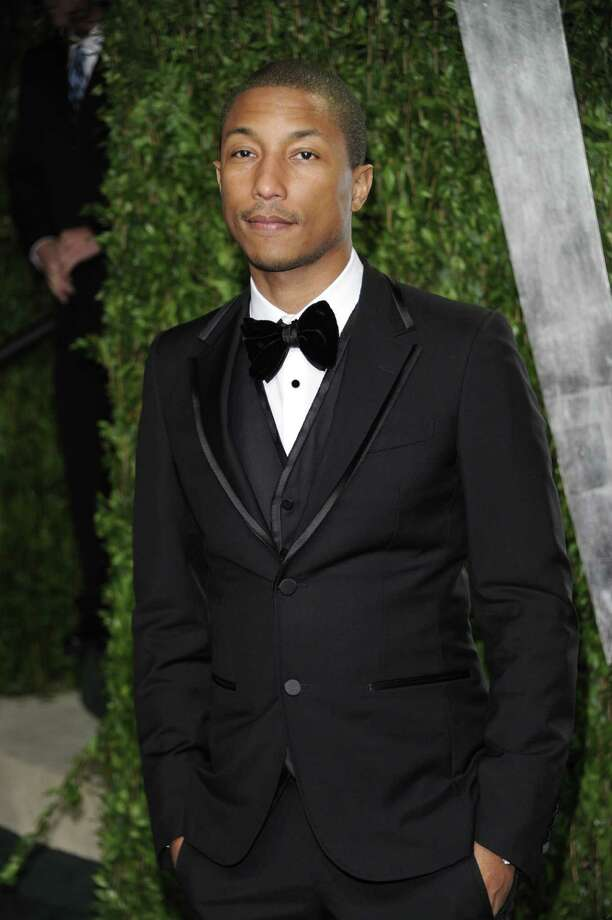 "FILE - Pharrell arrives at the Vanity Fair Oscar party in this Sunday, Feb. 26, 2012 file photo taken in West Hollywood, Calif. Pharrell is engaged in a battle with Marvin Gaye's estate over Robin Thicke's megahit ""Blurred Lines."" Speaking to The Associated Press on Thursday night Sept. 12, 2013, Pharrell said the two songs, ""Blurred Lines,"" and ""Got to Give it Up"" are completely different and not even in the same key. But he added that he is a huge fan of Gaye and that he's ""the king of all kings."" (AP Photo/Evan Agostini, File) ORG XMIT: NY109 Photo: Evan Agostini / AGOEV"