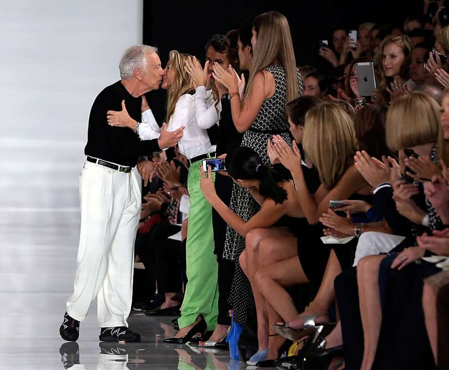 Who says no white pants after Labor Day? Not Ralph Lauren, seen kissing his wife after his Spring 2014 collection show at New York Fashion Week. Photo: Richard Drew, Associated Press