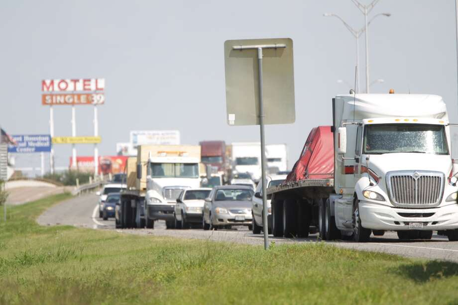 A police chase that ended in a crash in Houston is backing up traffic on I-10, Sept. 13, 2013.(Karen Warren / Houston Chronicle)