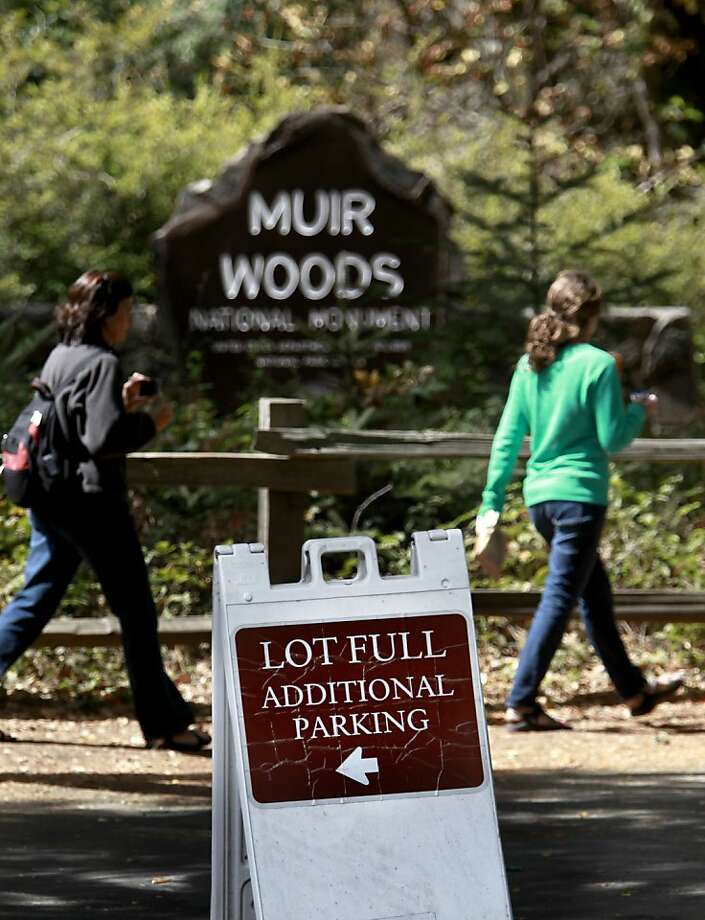 Signs direct drivers to the overflow parking areas after the lot at Muir Woods fills up. The National Park Service wants to build another lot. Photo: Michael Macor, The Chronicle