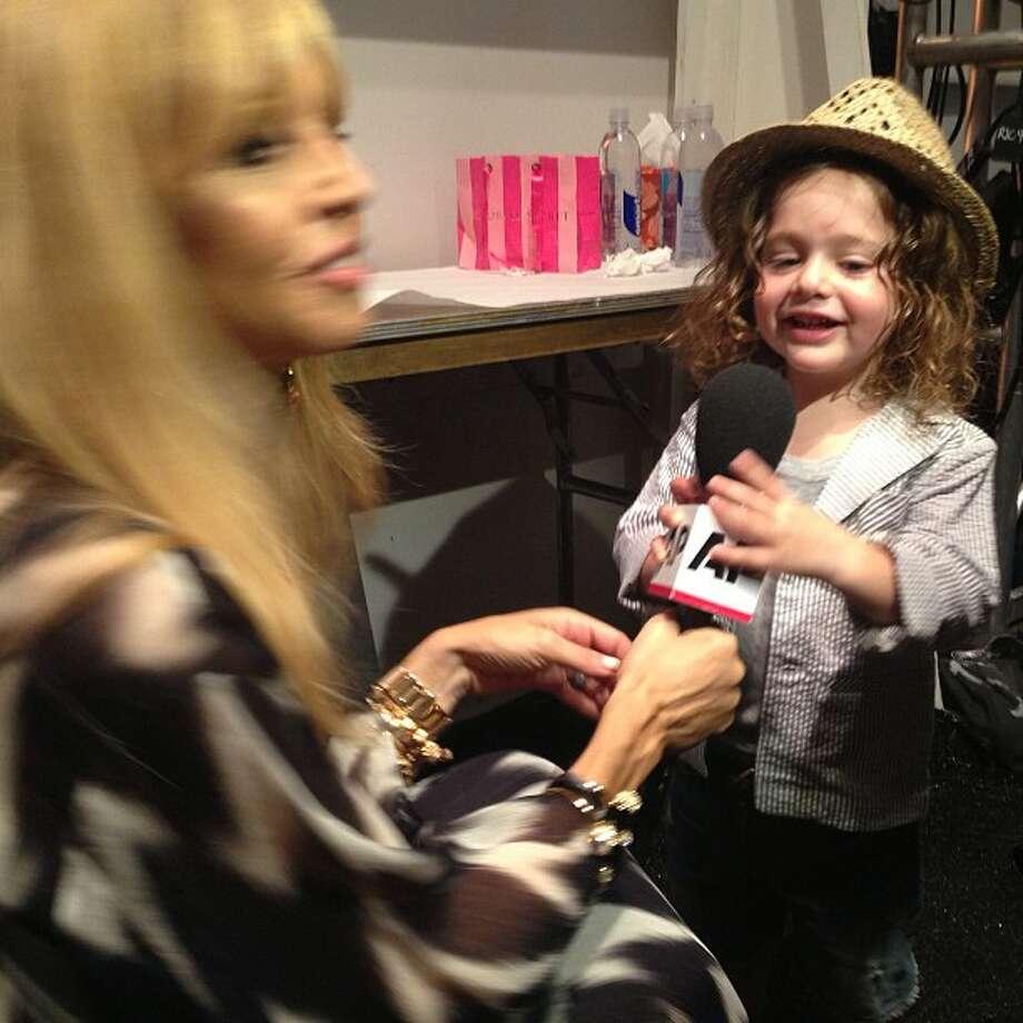 Rachel Zoe's baby interviews her before her show during Sept. 12, in this Instagram photo. Photo: Nicole Evatt, Associated Press / AP