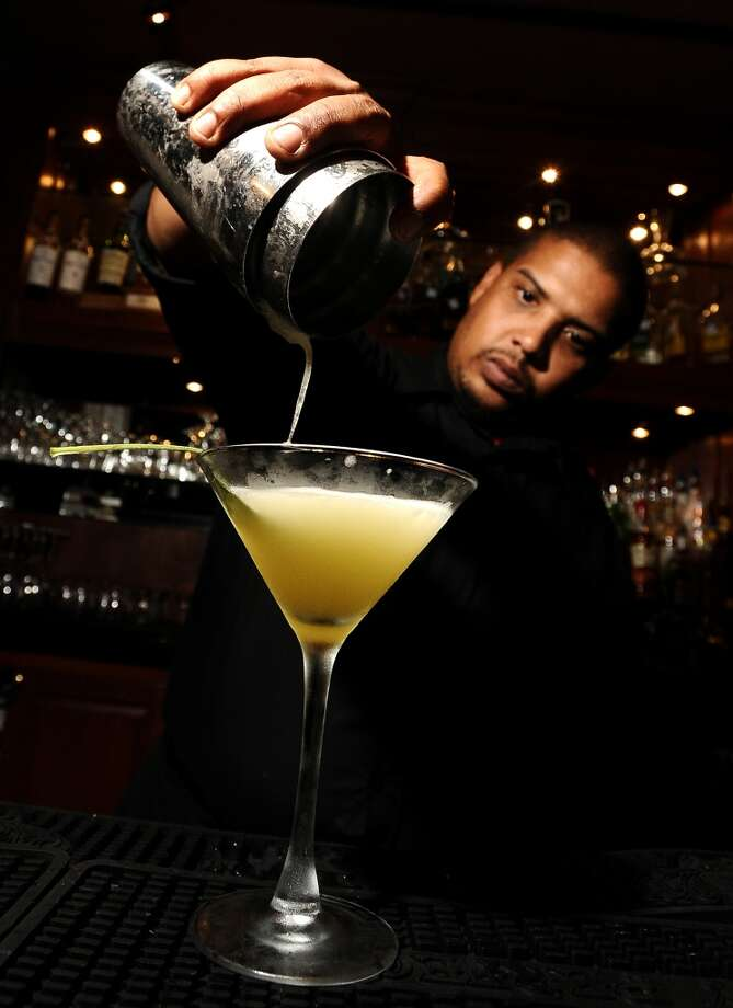 Sugas Deep South Cuisine and Jazz Bar bartender Adam Crawford mixes a First Growth. Edwards/cat5 Photo: Randy Edwards, Beaumont Enterprise