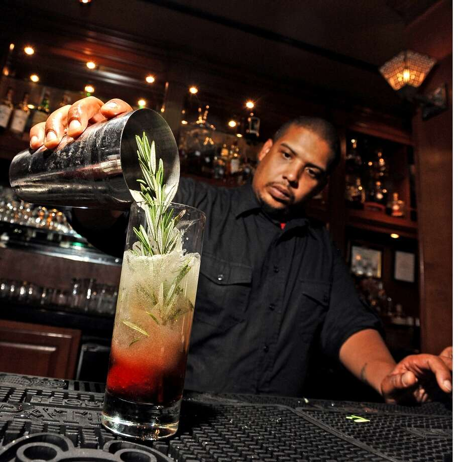 Sugas Deep South Cuisine and Jazz Bar bartender Adam Crawford makes a Sweet Rosemary. Randy Edwards/cat5 Photo: Randy Edwards, Beaumont Enterprise