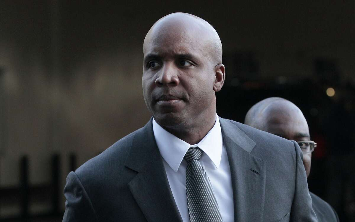 FILE - In this March 29, 2011, file photo, former baseball player Barry Bonds arrives for his trial at federal court in San Francisco. A federal appeals court in San Francisco on Friday, Sept. 13, 2013, upheld Bond's obstruction of justice conviction stemming from his 2003 testimony to a grand jury investigating performance enhancing drug use among elite athletes. (AP Photo/Jeff Chiu)